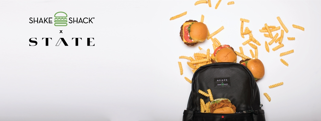 A picture of a State branded backpack with food around it.