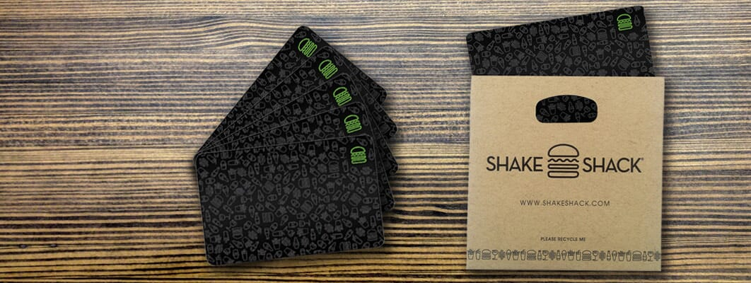An image of Shake Shack gift cards laid on a table with an envelope.